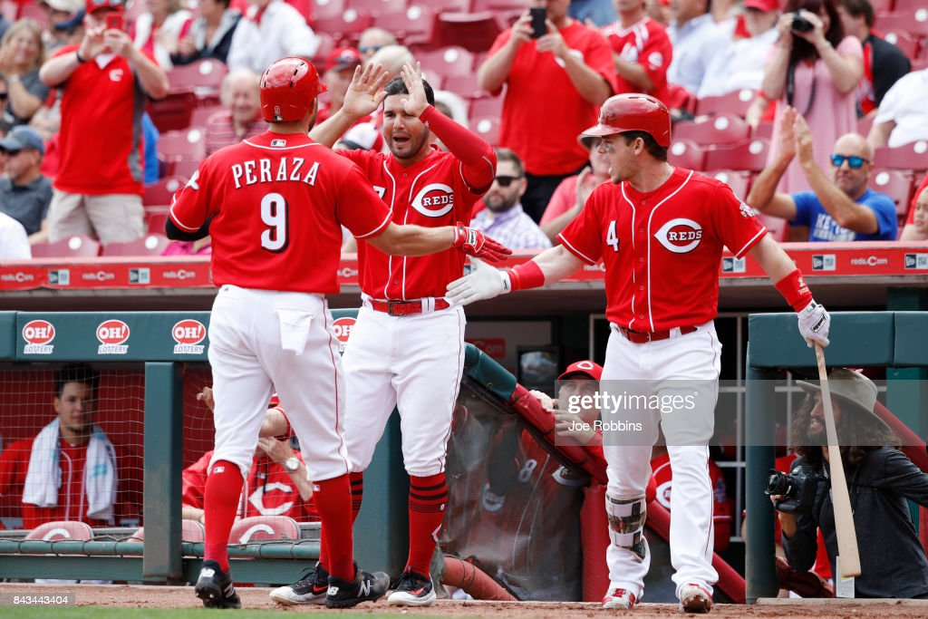 Jose Peraza #9 of the Cincinnati Reds is congratulated by Eugenio Suarez #7 after a solo home run in the eighth inning of a game against the Milwaukee Brewers at Great American Ball Park on September 6, 2017 in Cincinnati, Ohio. The Reds defeated the Brewers 7-1.
