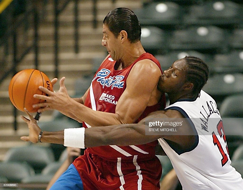 Jose Piculin Ortiz L of Puerto Rico is guarded b