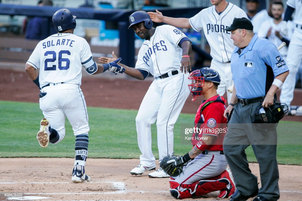 Jose Pirela #2 congratulates teammate Yangervis Solarte #26 of the San Diego Padres after hitting a home run during the 1st inning against the Washington Nationals at PETCO Park on August 19, 2017 in San Diego, California.