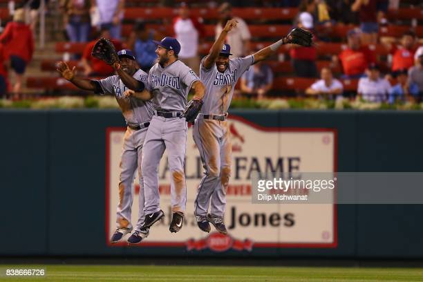 Jose Pirela Matt Szczur and Manuel Margot of the San Diego Padres celebrate after beating the St Louis Cardinals at Busch Stadium on August 24 2017...