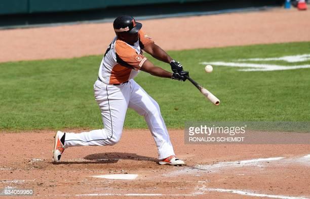 Jose Pirela of Aguilas del Zulia of Venezuela bats during a Caribbean Baseball Series match against Criollos de Caguas from Puerto Rico at the...