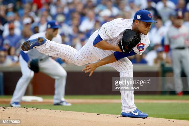 Jose Quintana of the Chicago Cubs pitches in the first inning against the Washington Nationals during game three of the National League Division...