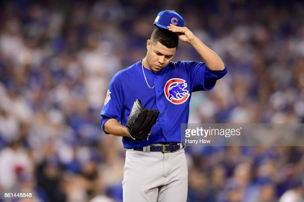 Jose Quintana of the Chicago Cubs reacts after Charlie Culberson of the Los Angeles Dodgers hits a a sac fly to score Austin Barnes during the fifth...
