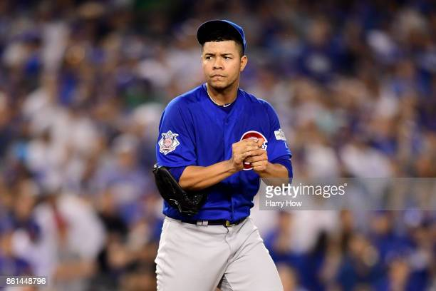 Jose Quintana of the Chicago Cubs reacts after walking Austin Barnes of the Los Angeles Dodgers during the fifth inning in Game One of the National...