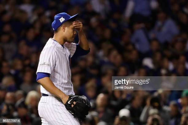 Jose Quintana of the Chicago Cubs reacts in the third inning against the Los Angeles Dodgers during game five of the National League Championship...