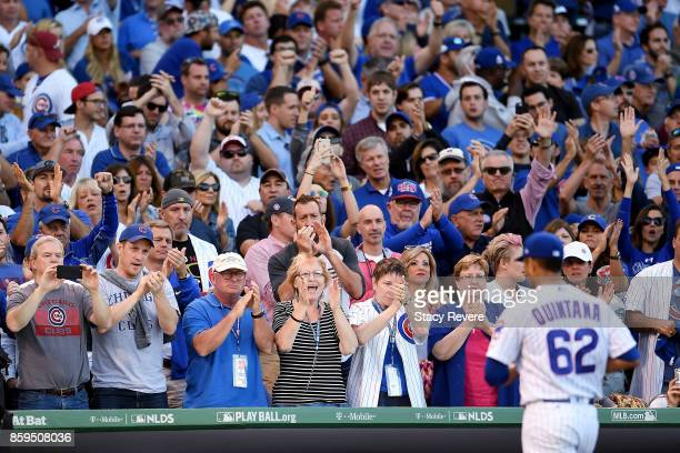 Jose Quintana of the Chicago Cubs receives a standing ovation after being relieved in the sixth inning against the Washington Nationals during game...