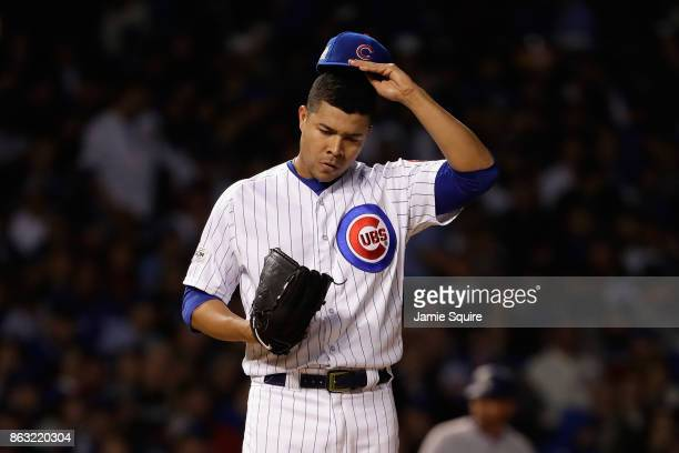 Jose Quintana of the Chicago Cubs stands on the mound in the first inning against the Los Angeles Dodgers during game five of the National League...