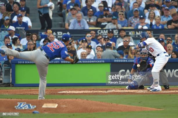 Jose Quintana of the Chicago Cubs strikes out Justin Turner of the Los Angeles Dodgers during the first inning in Game One of the National League...