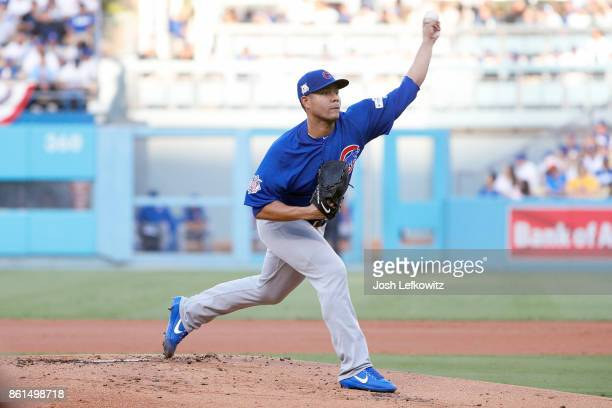 Jose Quintana of the Chicago Cubs throws a pitch against the Los Angeles Dodgers during the first inning in Game One of the National League...