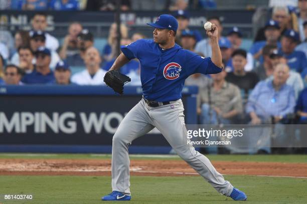 Jose Quintana of the Chicago Cubs throws out Enrique Hernandez of the Los Angeles Dodgers after fielding the ball during the second inning in Game...