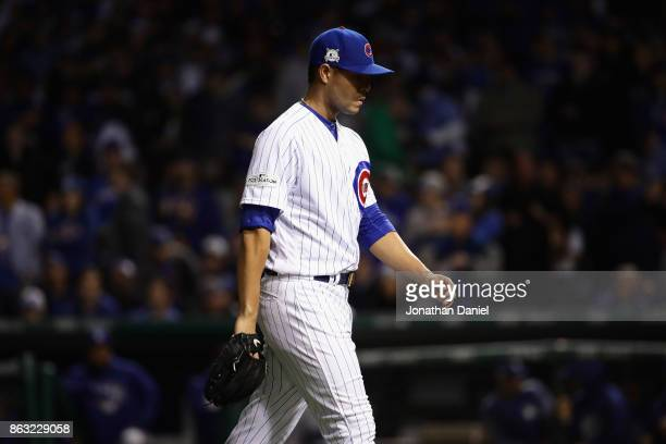 Jose Quintana of the Chicago Cubs walks off the field after being relieved in the third inning against the Los Angeles Dodgers during game five of...