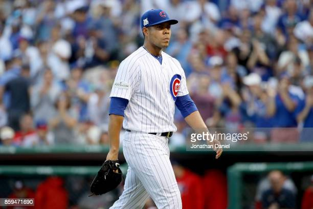 Jose Quintana of the Chicago Cubs walks off the field in the first inning against the Washington Nationals during game three of the National League...