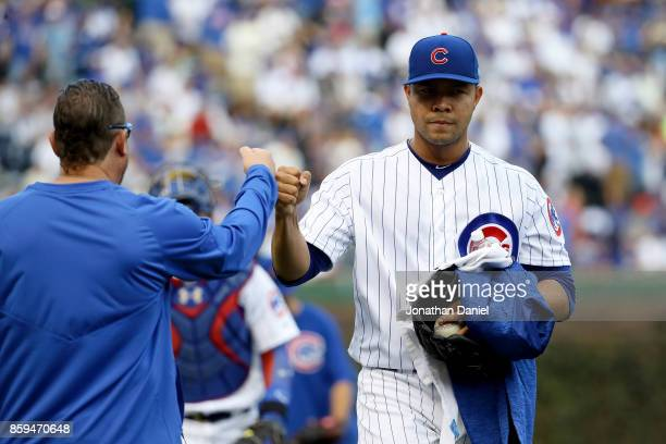 Jose Quintana of the Chicago Cubs walks to the dugout before game three of the National League Division Series against the Washington Nationals at...