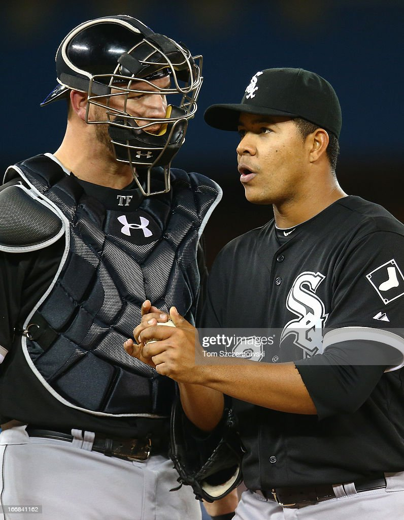 Jose Quintana #62 of the Chicago White Sox gets a visit to the mound from <a gi-track='captionPersonalityLinkClicked' href=/galleries/search?phrase=Tyler+Flowers&family=editorial&specificpeople=4217244 ng-click='$event.stopPropagation()'>Tyler Flowers</a> #21 during MLB game action against the Toronto Blue Jays on April 17, 2013 at Rogers Centre in Toronto, Ontario, Canada.