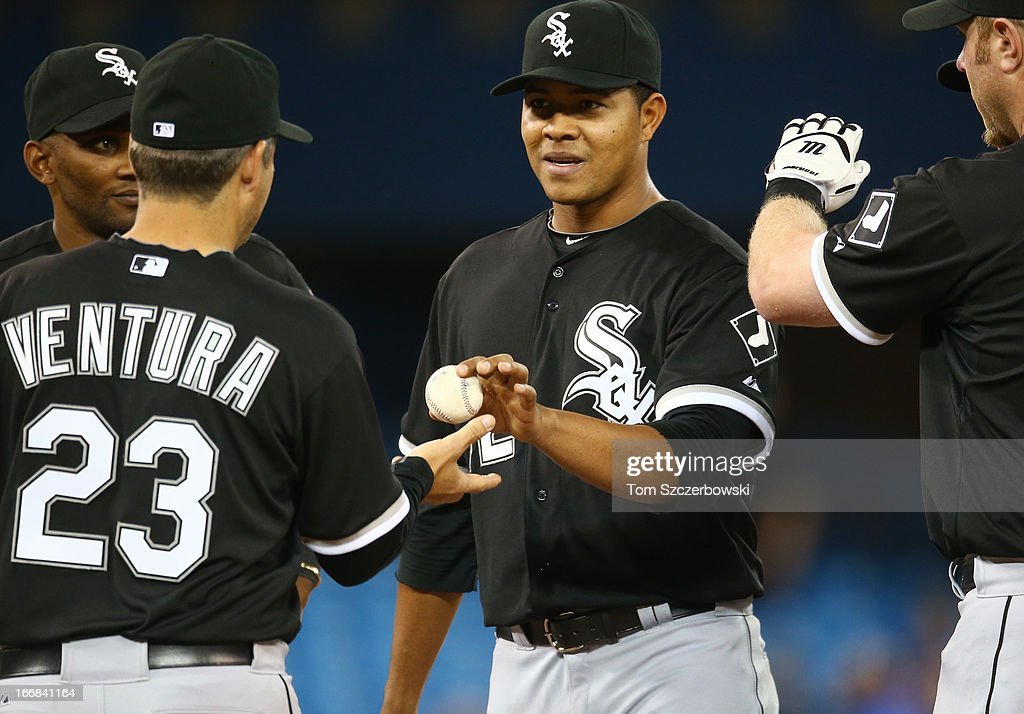 Jose Quintana #62 of the Chicago White Sox hands the ball to manager <a gi-track='captionPersonalityLinkClicked' href=/galleries/search?phrase=Robin+Ventura&family=editorial&specificpeople=211486 ng-click='$event.stopPropagation()'>Robin Ventura</a> #23 after being relieved in the seventh inning during MLB game action against the Toronto Blue Jays on April 17, 2013 at Rogers Centre in Toronto, Ontario, Canada.