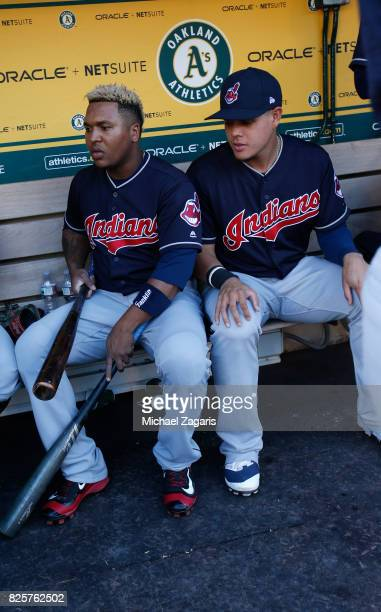 Jose Ramirez and Brandon Guyer of the Cleveland Indians sit in the dugout prior to the game against the Oakland Athletics at the Oakland Alameda...