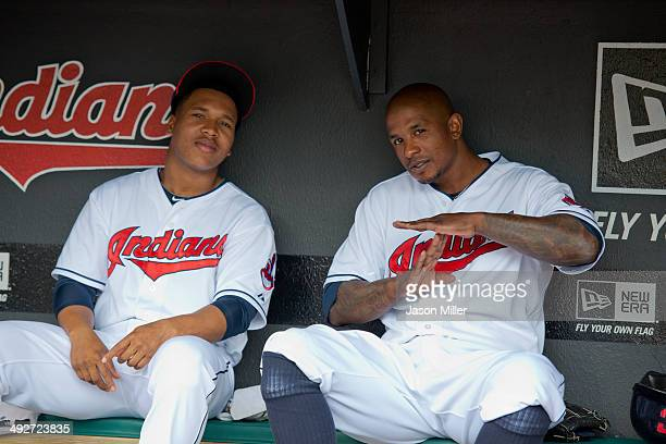 Jose Ramirez and Nyjer Morgan of the Cleveland Indians smile for the camera in the dugout prior to the game against the Minnesota Twins at...