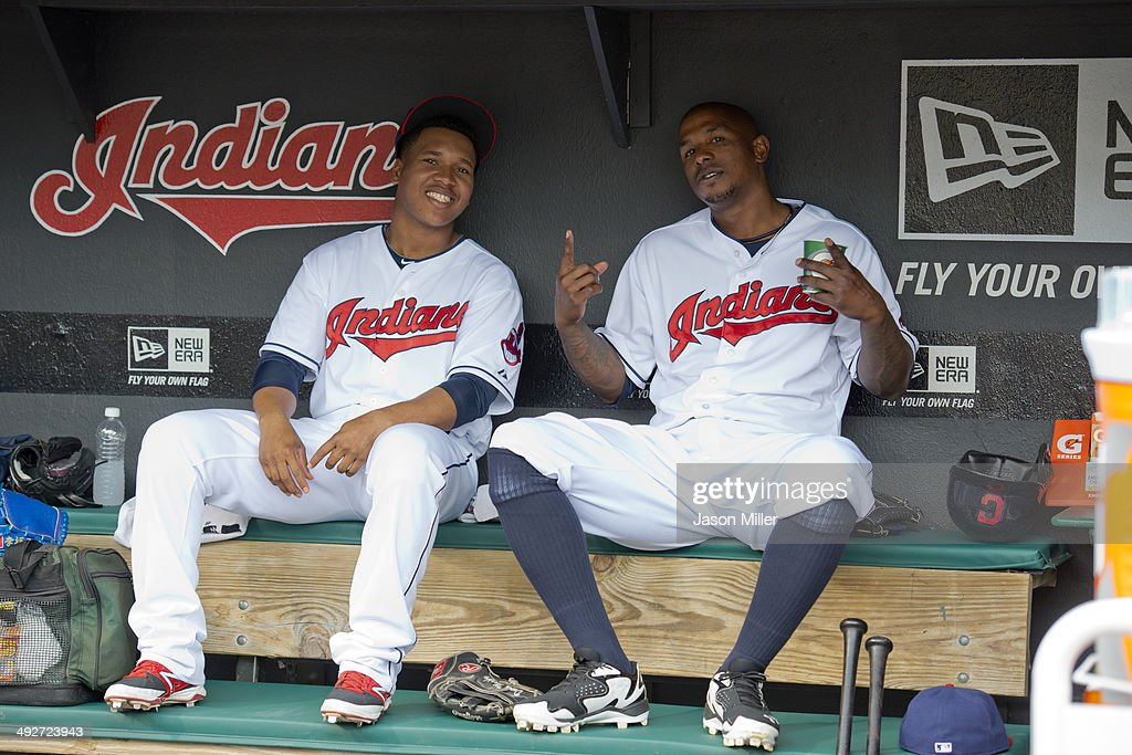 Jose Ramirez #11 and Nyjer Morgan #6 of the Cleveland Indians smile for the camera in the dugout prior to the game against the Minnesota Twins at Progressive Field on May 8, 2014 in Cleveland, Ohio.