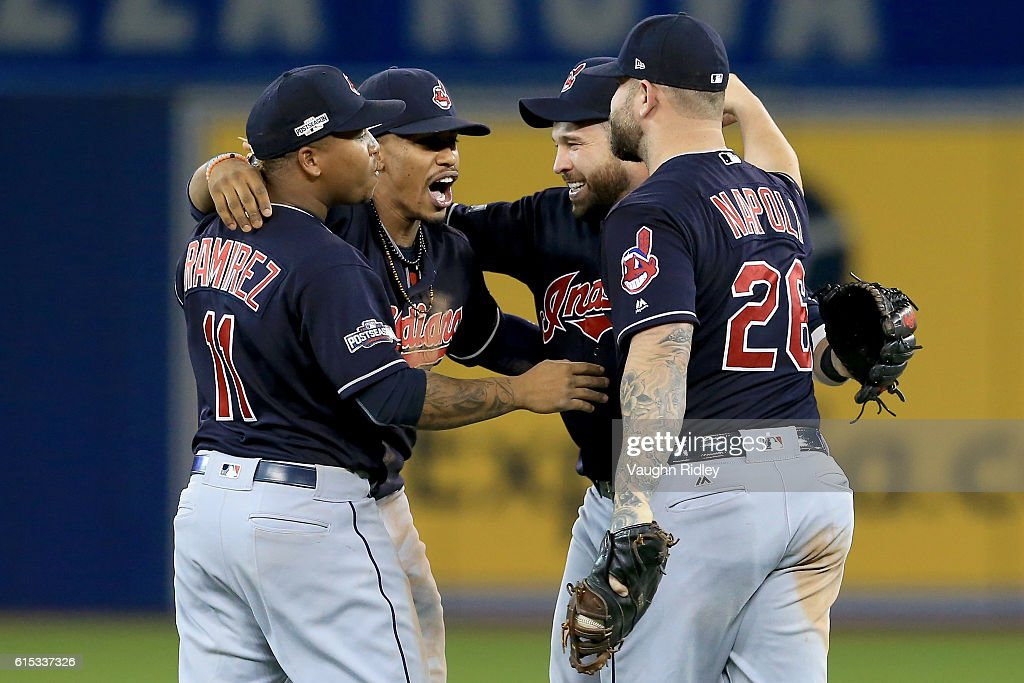 Jose Ramirez #11, Francisco Lindor #12, Jason Kipnis #22 and Mike Napoli #26 of the Cleveland Indians celebrate after defeating the Toronto Blue Jays with a score of 4 to 2 in game three of the American League Championship Series at Rogers Centre on October 17, 2016 in Toronto, Canada.