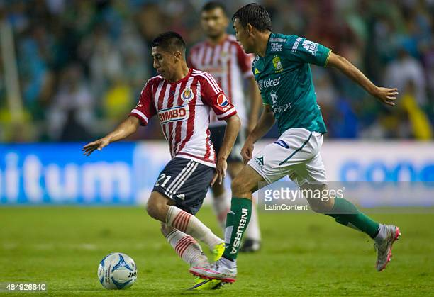 Jose Ramirez of Chivas fights for the ball with Miguel Ibarra of Leon during a 6th round match between Leon and Chivas as part of the Apertura 2015...