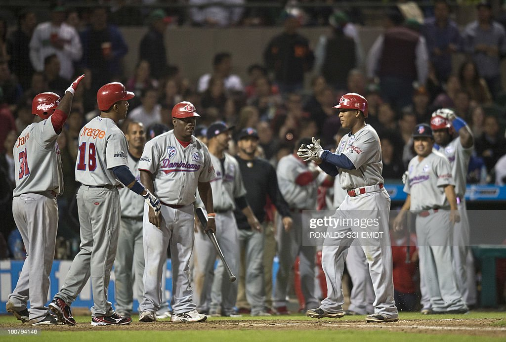 Jose Ramirez (R) of Leones del Escogido of Dominican Republic celebrates his home run against Yaquis de Obregon of Mexico with teammates during the 2013 Caribbean baseball series in Hermosillo, Sonora State, northern Mexico on February 5, 2013. AFP PHOTO / Ronaldo Schemidt
