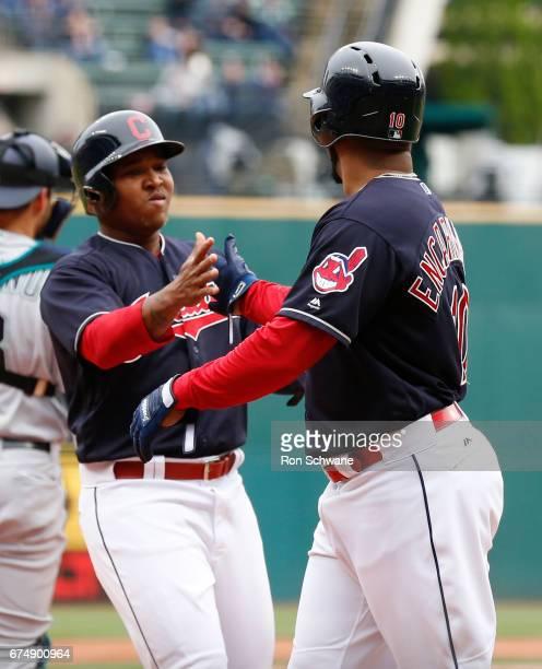 Jose Ramirez of the Cleveland Indians and Edwin Encarnacion celebrate after scoring on a single by Lonnie Chisenhall off Yovani Gallardo of the...