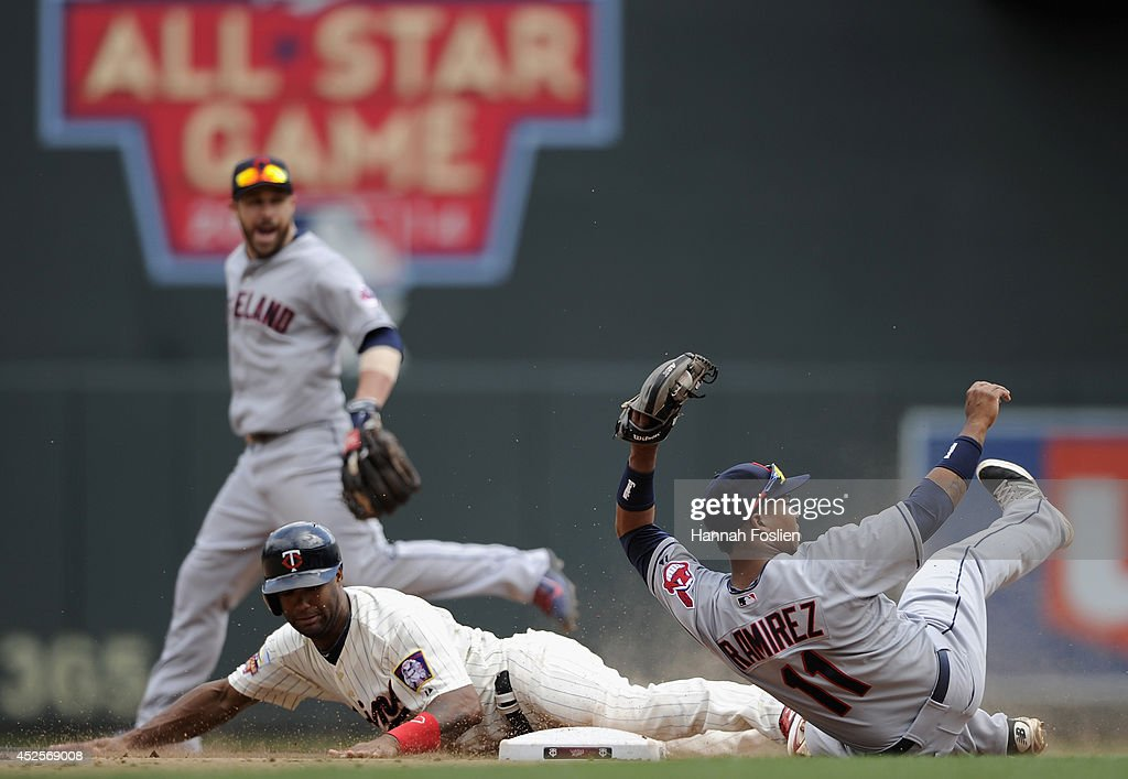 Jose Ramirez #11 of the Cleveland Indians catches <a gi-track='captionPersonalityLinkClicked' href=/galleries/search?phrase=Danny+Santana&family=editorial&specificpeople=6602314 ng-click='$event.stopPropagation()'>Danny Santana</a> #39 of the Minnesota Twins stealing second base during the seventh inning of the game on July 23, 2014 at Target Field in Minneapolis, Minnesota. The Twins defeated the Indians 3-1.