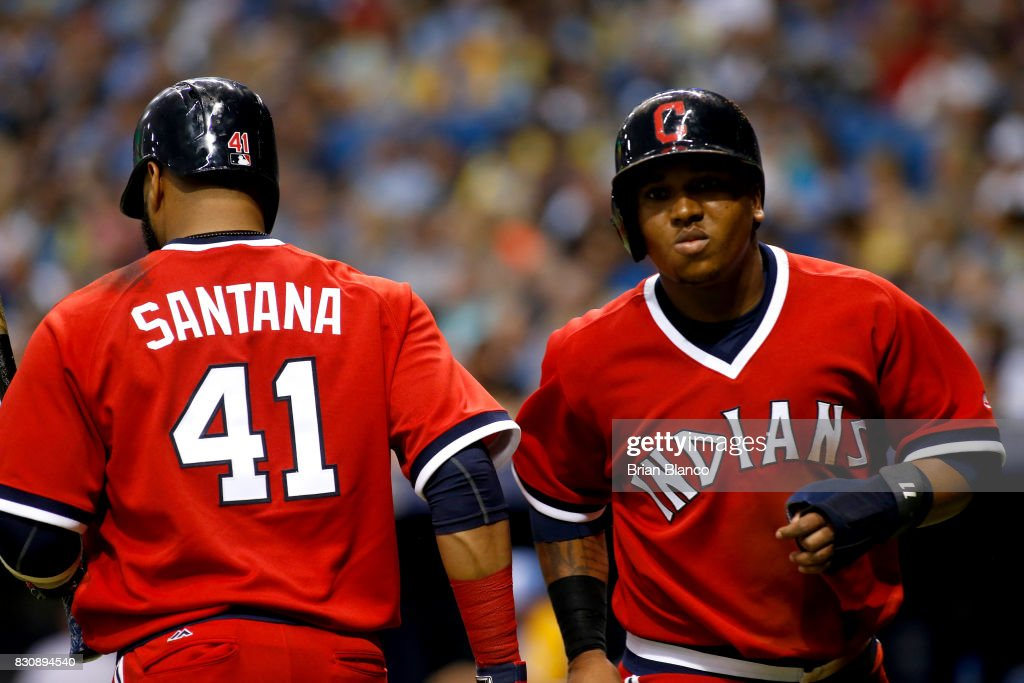 Jose Ramirez #11 of the Cleveland Indians celebrates with Carlos Santana #41 of the Cleveland Indians after scoring off of an RBI single by Jay Bruce during the sixth inning of a game against the Tampa Bay Rays on August 12, 2017 at Tropicana Field in St. Petersburg, Florida.
