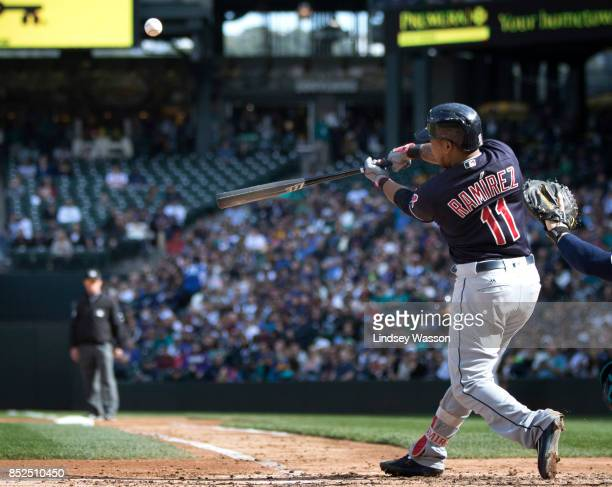 Jose Ramirez of the Cleveland Indians hits a sac fly to right field to score Austin Jackson of the Cleveland Indians in the third inning against the...