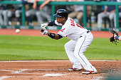 Jose Ramirez of the Cleveland Indians hits a sacrifice bunt during the first inning against the Seattle Mariners at Progressive Field on July 31 2014...