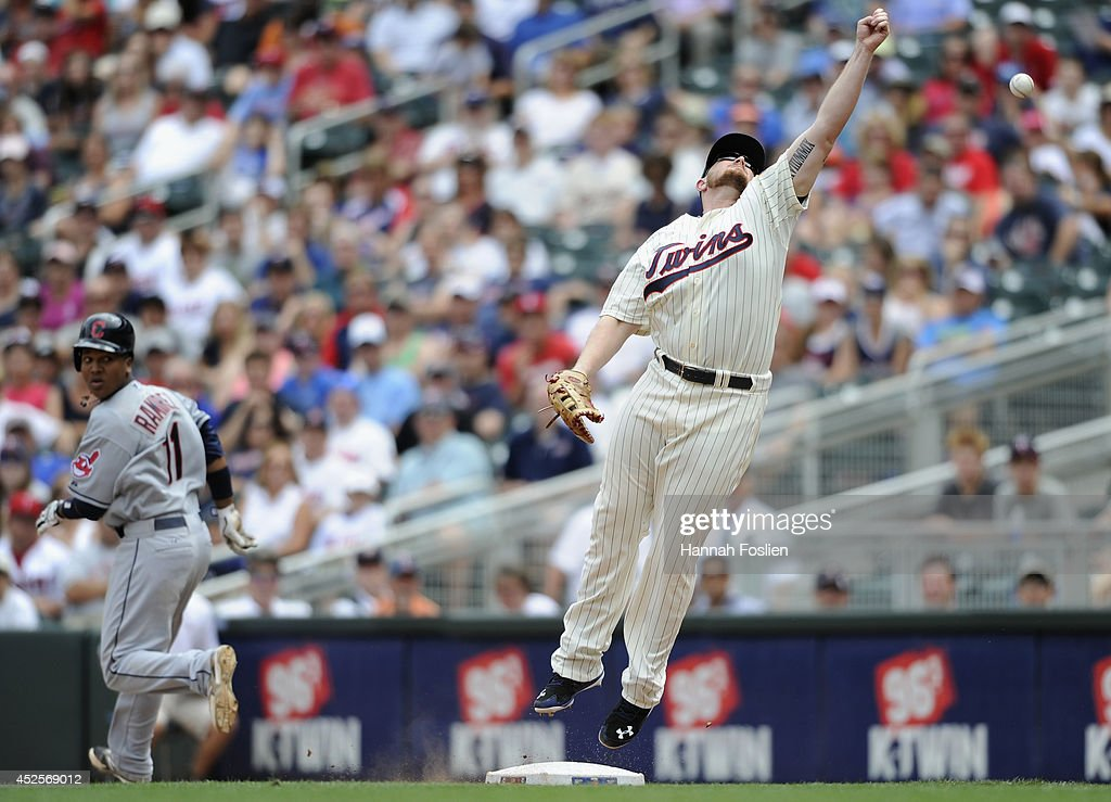 Jose Ramirez #11 of the Cleveland Indians is safe at first base as <a gi-track='captionPersonalityLinkClicked' href=/galleries/search?phrase=Chris+Parmelee&family=editorial&specificpeople=713101 ng-click='$event.stopPropagation()'>Chris Parmelee</a> #27 of the Minnesota Twins is unable to field the ball during the eighth inning of the game on July 23, 2014 at Target Field in Minneapolis, Minnesota. The Twins defeated the Indians 3-1.