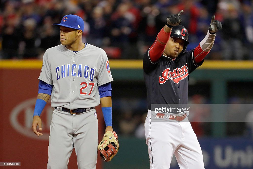Jose Ramirez #11 of the Cleveland Indians reacts after hitting a double during the sixth inning as Addison Russell #27 of the Chicago Cubs looks on in Game One of the 2016 World Series at Progressive Field on October 25, 2016 in Cleveland, Ohio.