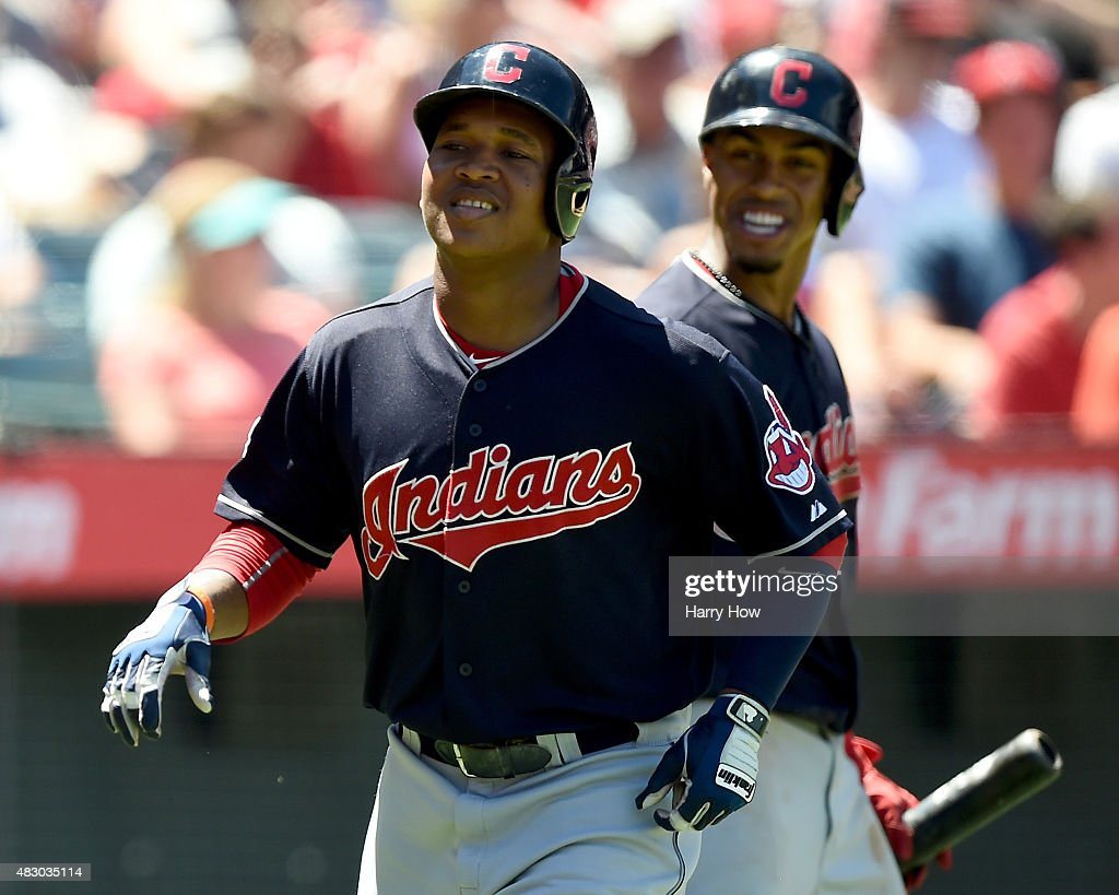 Jose Ramirez #11 of the Cleveland Indians reacts to his homerun with Francisco Lindor #12 to take a 2-1 lead over the Los Angeles Angels during the sixth inning at Angel Stadium of Anaheim on August 5, 2015 in Anaheim, California.