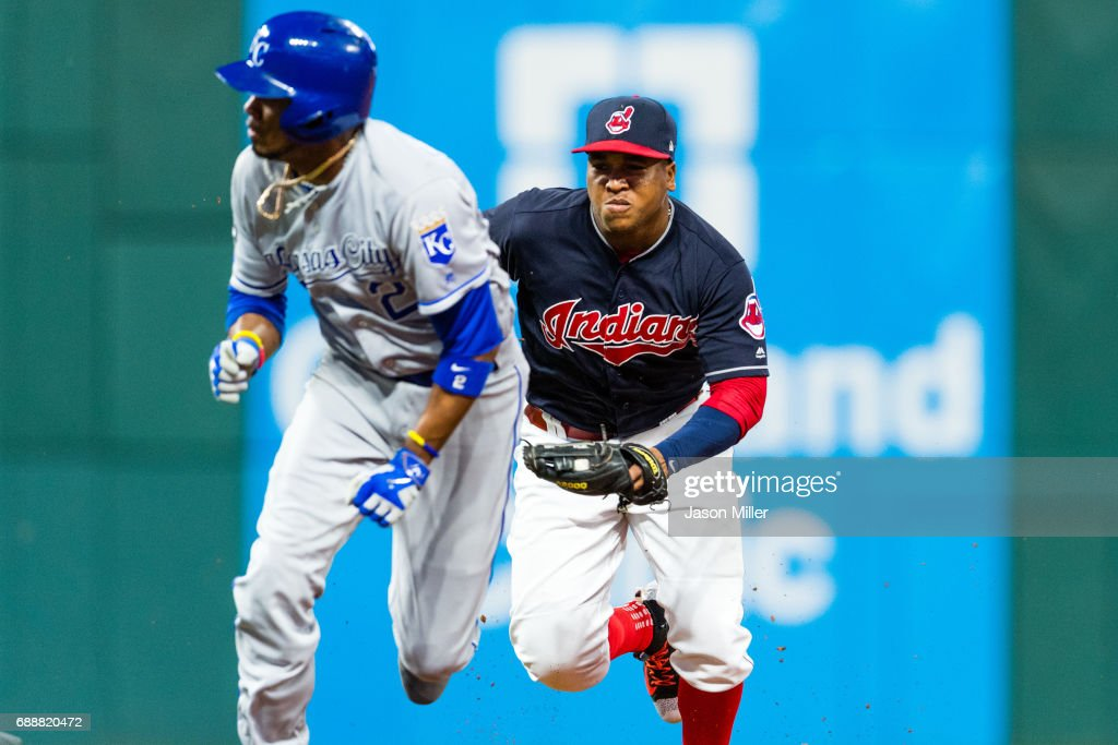 Jose Ramirez #11 of the Cleveland Indians runs down Alcides Escobar #2 of the Kansas City Royals to end the top of the seventh inning at Progressive Field on May 26, 2017 in Cleveland, Ohio.