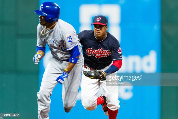 Jose Ramirez of the Cleveland Indians runs down Alcides Escobar of the Kansas City Royals to end the top of the seventh inning at Progressive Field...