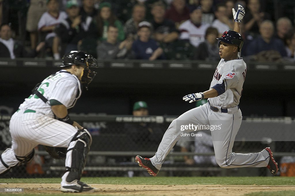 Jose Ramirez #62 of the Cleveland Indians scores on Josh Phegley #36 of the Chicago White Sox during in the ninth inning of their MLB game at U.S. Cellular Field on September 14, 2013 in Chicago, Illinois.