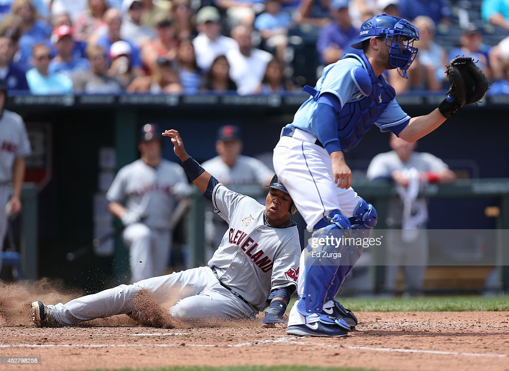 Jose Ramirez #11 of the Cleveland Indians slides into home past <a gi-track='captionPersonalityLinkClicked' href=/galleries/search?phrase=Brett+Hayes&family=editorial&specificpeople=795648 ng-click='$event.stopPropagation()'>Brett Hayes</a> #12 of the Kansas City Royals to score on a Michael Brantley sacrifice fly in the fifth inning against the Kansas City Royals at Kauffman Stadium on July 27, 2014 in Kansas City, Missouri.