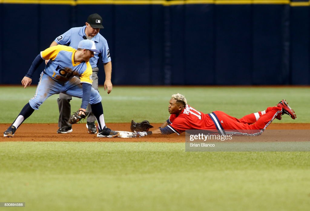 Jose Ramirez #11 of the Cleveland Indians slides safely into second base ahead of second baseman Brad Miller #13 of the Tampa Bay Rays after hitting a double off of pitcher Chris Archer during the sixth inning of a game on August 12, 2017 at Tropicana Field in St. Petersburg, Florida.