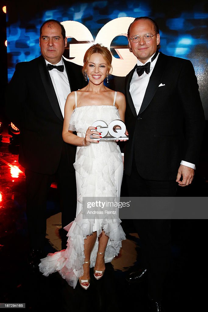 (TO BE USED EXCLUSIVELY FOR POST-EVENT REPORTING TO GQ MEN OF THE YEAR 2013, DO NOT USE AFTER) Jose Redondo-Vega (L), <a gi-track='captionPersonalityLinkClicked' href=/galleries/search?phrase=Kylie+Minogue&family=editorial&specificpeople=201671 ng-click='$event.stopPropagation()'>Kylie Minogue</a> and Moritz von Laffert on stage at the end of the GQ Men Of The Year Award ceremony at Komische Oper on November 7, 2013 in Berlin, Germany.