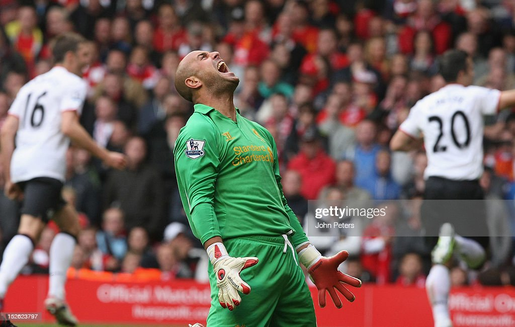Jose Reina of Liverpool reacts to Robin van Persie of Manchester United scoring their second goal during the Barclays Premier League match between Liverpool and Manchester United at Anfield on September 23, 2012 in Liverpool, England.