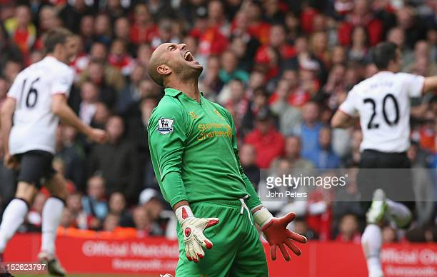 Jose Reina of Liverpool reacts to Robin van Persie of Manchester United scoring their second goal during the Barclays Premier League match between...