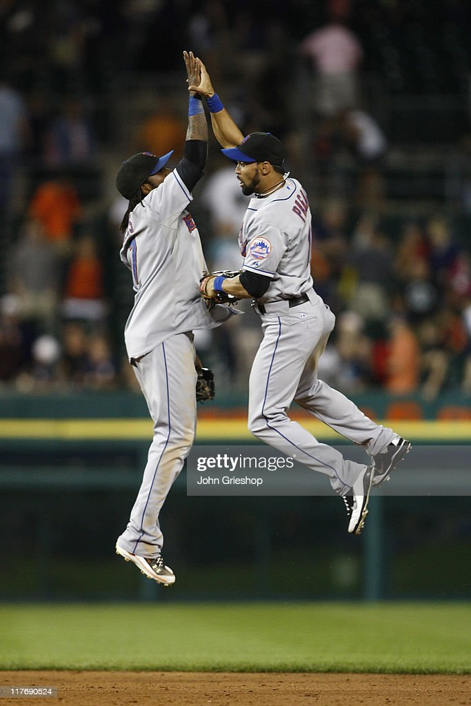 Jose Reyes #7 and <a gi-track='captionPersonalityLinkClicked' href=/galleries/search?phrase=Angel+Pagan&family=editorial&specificpeople=666596 ng-click='$event.stopPropagation()'>Angel Pagan</a> #16 of the New York Mets celebrate a victory during the game against the Detroit Tigers on June 29, 2011 at Comerica Park in Detroit, Michigan. The Mets defeated the Tigers 16-9.