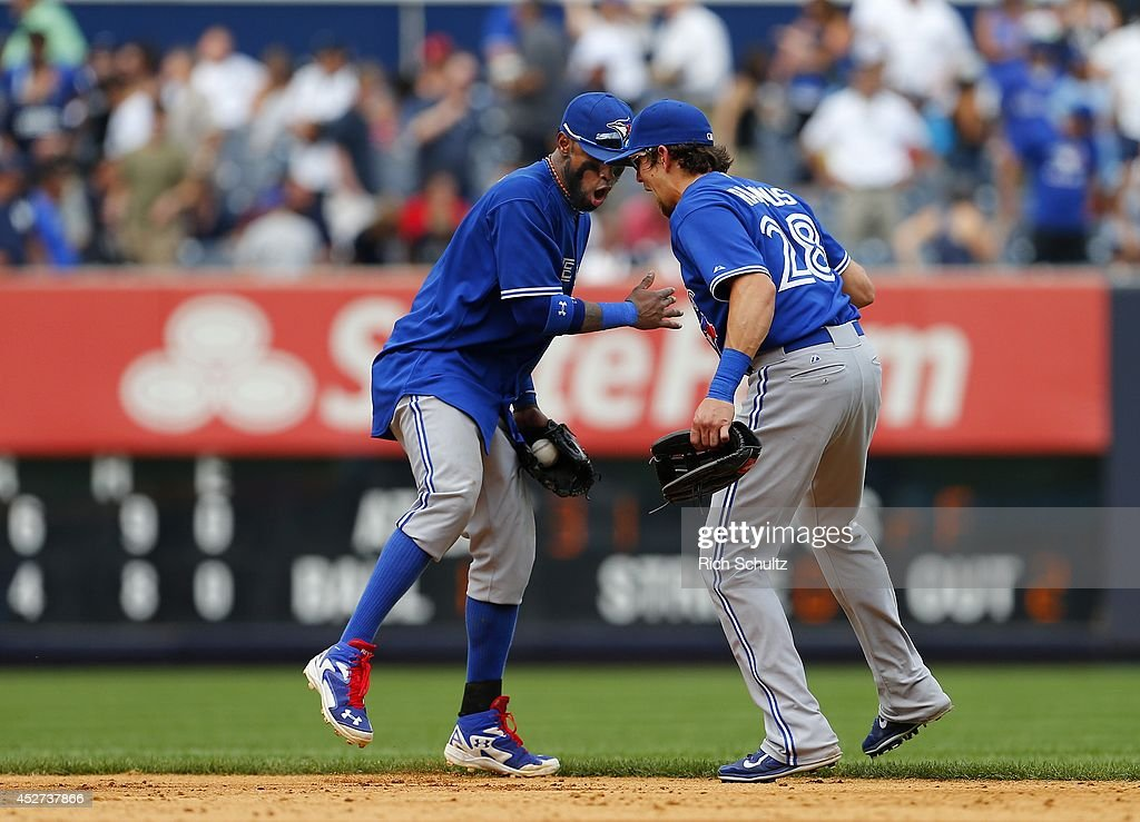 Jose Reyes #7 and <a gi-track='captionPersonalityLinkClicked' href=/galleries/search?phrase=Colby+Rasmus&family=editorial&specificpeople=3988372 ng-click='$event.stopPropagation()'>Colby Rasmus</a> #28 of the Toronto Blue Jays celebrate after defeating the New York Yankees 6-4 during a MLB baseball game at Yankee Stadium on July 26, 2014 in the Bronx borough of New York City.