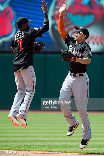 Jose Reyes and Giancarlo Stanton of the Miami Marlins celebrate after defeating the Cleveland Indians during an interleague game at Progressive Field...