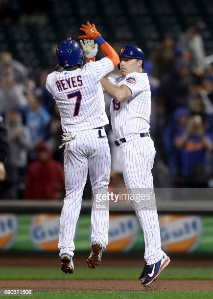 Jose Reyes and Jay Bruce of the New York Mets celebrate the win over the Milwaukee Brewers on May 30 2017 at Citi Field in the Flushing neighborhood...