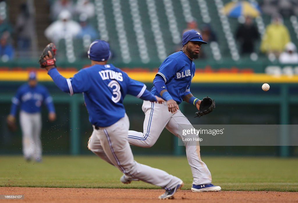 Jose Reyes #7 and <a gi-track='captionPersonalityLinkClicked' href=/galleries/search?phrase=Maicer+Izturis&family=editorial&specificpeople=239100 ng-click='$event.stopPropagation()'>Maicer Izturis</a> #3 of the Toronto Blue Jays give chase to a ground ball single up the middle from Austin Jackson #14 of the Detroit Tigers during the seventh inning of the game at Comerica Park on April 11, 2013 in Detroit, Michigan. The Tigers defeated the Blue Jays 11-1.