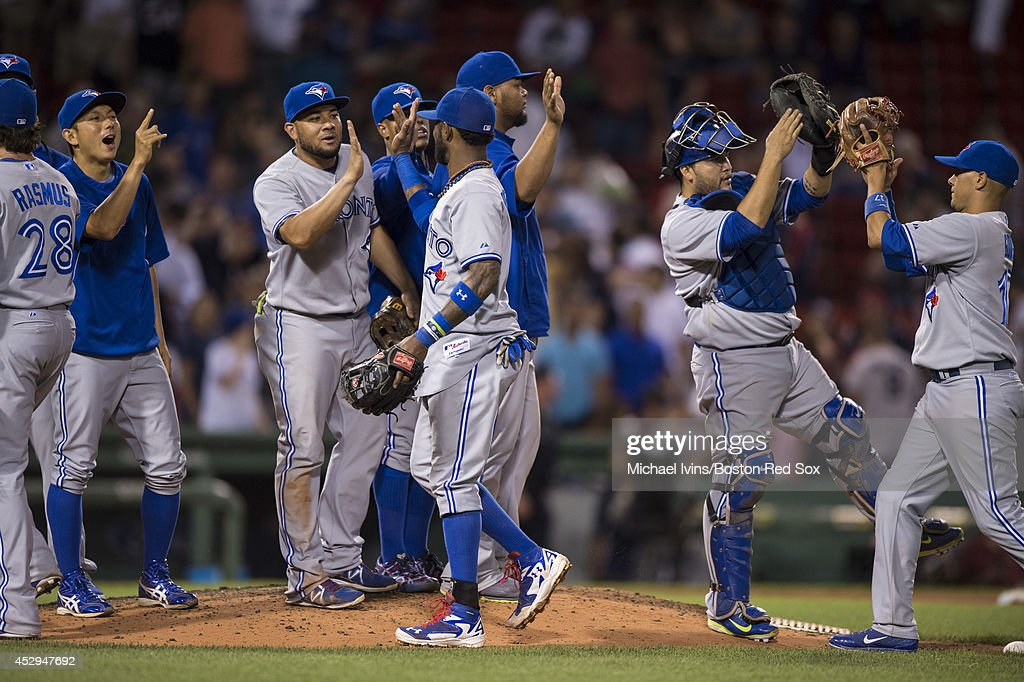 Jose Reyes #7 and members of the Toronto Blue Jays celebrate a 6-1 win and a series sweep against the Boston Red Sox on July 30, 2014 at Fenway Park in Boston, Massachusetts. Photo by Michael Ivins/Boston Red Sox/Getty Images)