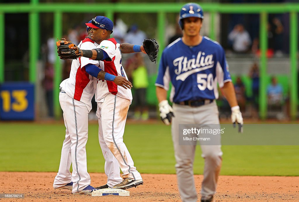 Jose Reyes #7 and <a gi-track='captionPersonalityLinkClicked' href=/galleries/search?phrase=Robinson+Cano&family=editorial&specificpeople=538362 ng-click='$event.stopPropagation()'>Robinson Cano</a> #24 of the Dominican Republic celebrate after winning a World Baseball Classic second round game against Italy at Marlins Park on March 12, 2013 in Miami, Florida.