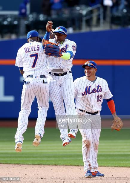 Jose Reyes and Yoenis Cespedes of the New York Mets celebrate the win as teammate Asdrubal Cabrera looks on after the win over the Atlanta Braves...