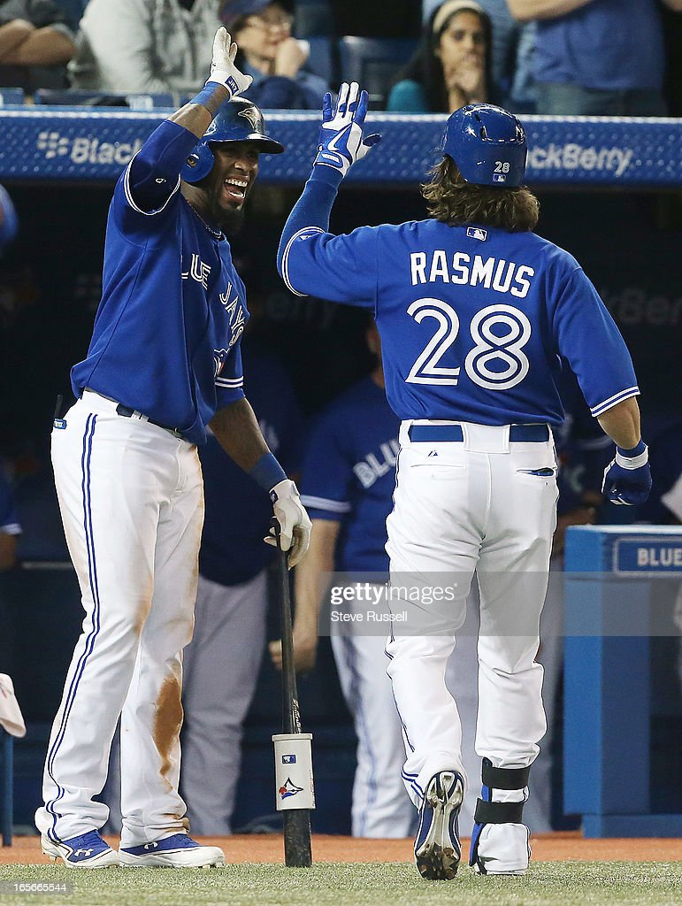 Jose Reyes congratulates Colby Rasmus on his first hit of the season, a homer, as the Toronto Blue Jays play the Cleveland Indians at the Rogers Centre in Toronto.